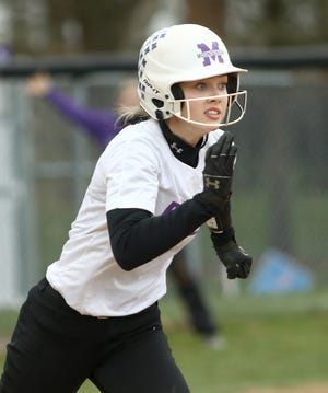 Mount Union's Grace Heath heads towards first base during the first game of a doubleheader against Otterbein at Mount Union Sunday, March 28, 2021.