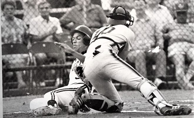 Moises Alou, a future major league star, slides home for the Augusta Pirates in 1988.