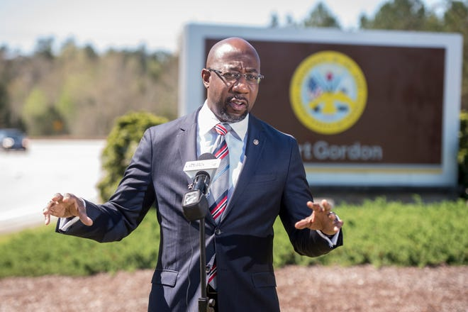 U.S. Sen. Raphael Warnock talks with reporters outside Fort Gordon after touring the facility near Augusta, Ga., Monday morning March 29, 2021.