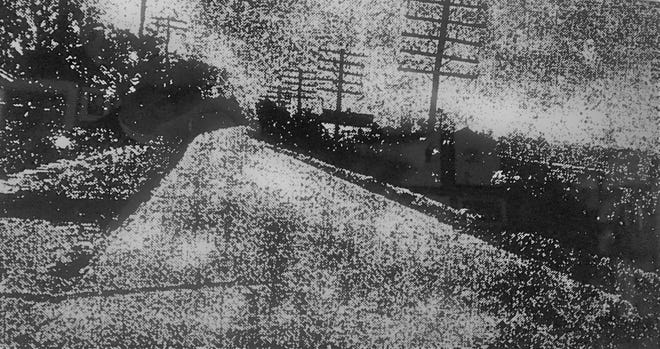 An old newspaper clipping touts the paved highway to Milledgeville.
