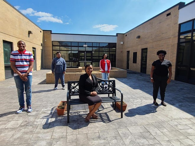 Principal Shondra Taylor is pictured with several of her students in the EMS school courtyard.