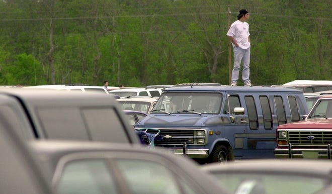 Extremely high turnout for Augusta's Skyfest airshow in 2000 left many trapped in traffic. Tony McLane of North Augusta decided to watch the show from atop his van.