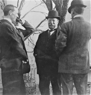 William Howard Taft, both a president and later Supreme Court chief justice, shares an informal moment.
