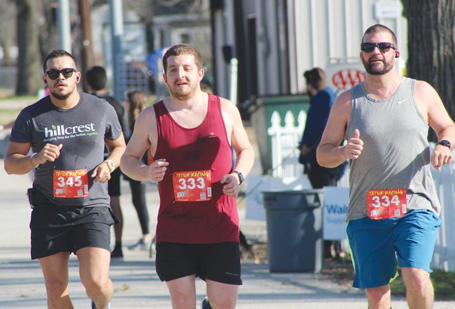 Raul Lazcano, Michael Sinn and Robbie Haxton speed toward the final stretch of last Saturday's KLIFE 10K Run the Ville in Bartlesville.