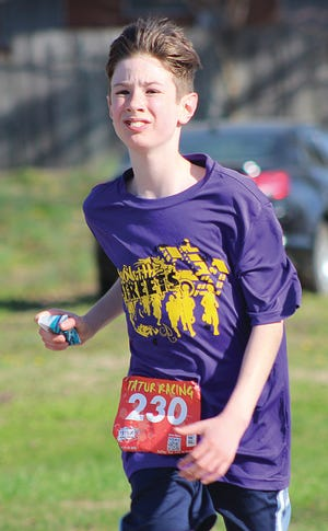 Hudson Praetorious was one of the youngest runners in last weekend's KLIFE 10K Run the Ville and finished in less than an hour.