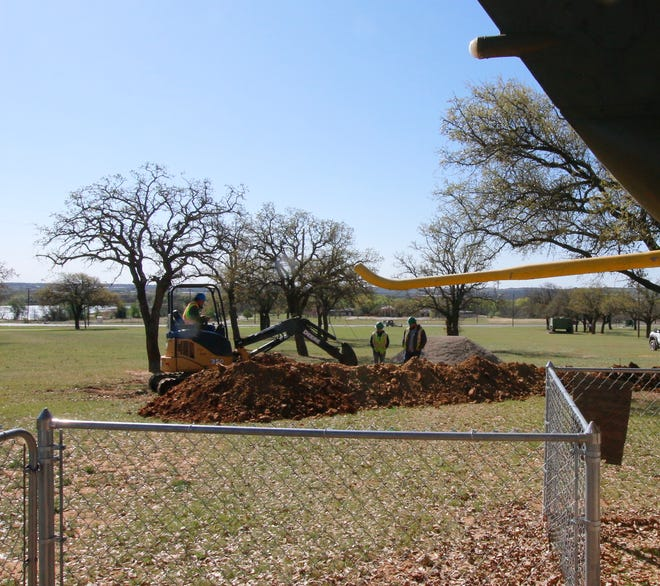 City of Brownwood workers dig a ditch Monday for electrical and sewer lines for a rest room that will be built at the Central Texas Veterans Memorial.