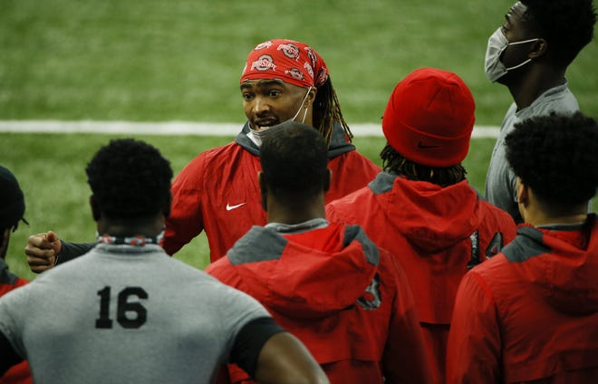 Ohio State Buckeyes cornerback Shaun Wade (24) speaks to teammates before the start of the Big Ten Championship football game between the Ohio State Buckeyes and the Northwestern Wildcats on Saturday, Dec. 19, 2020 at Lucas Oil Stadium in Indianapolis.