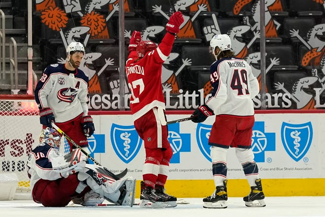 Red Wings forward Evgeny Svechnikov reacts to the go-ahead goal by Michael Rasmussen in Sunday's 4-1 victory over the Blue Jackets.