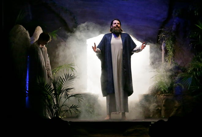 """Jesus, portrayed by David Ericson, rises from the dead and emerges from the cave in which he was entombed after being crucified during a dramatic Easter presentation called """"Unstoppable Love"""" at Fellowship Baptist Church, which resumed its annual production this year."""