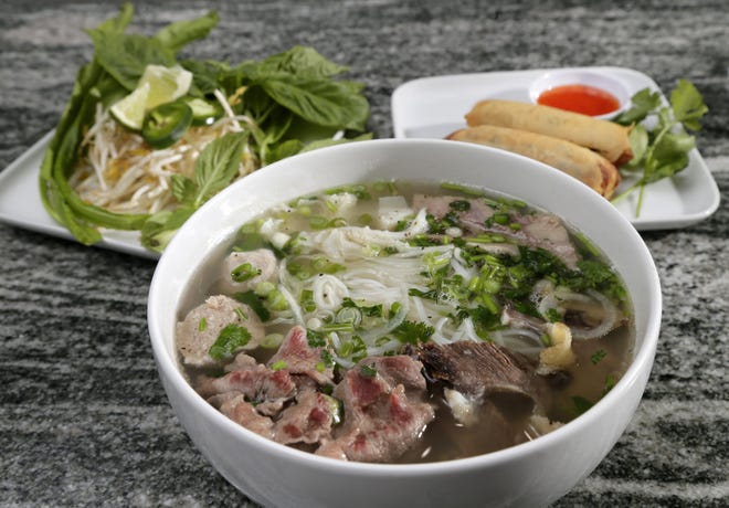 Dac Biet pho with eye of round beef, brisket, soft tendon, beef meatballs and a side of ground chicken summer rolls at Pho Le Vietnamese Cuisine on Morse Road.