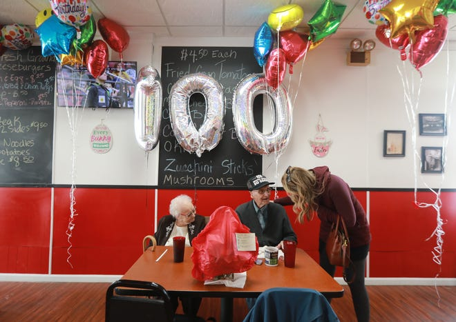 Amanda Quintanilla says hello to her grandfather Howard Shumate at his 100th birthday party Sunday at Ben & Joy's restaurant in Mount Sterling, where he has eaten nearly every day for years. Shumate has lived in this Madison County village of 1,800 people his entire life, raising his family and farming.