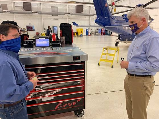 U.S. Sen. Bill Cassidy (right), R-La., chats with Aviation Maintenance Manager Mike Leger at the Bristow Group heliport Monday at the Houma-Terrebonne Airport.