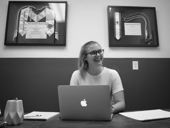 Kayla Surratt started Pinnacle Digital Marketing Firm in October. 'One of the things that I got a passion behind while starting this [company] is helping businesses go from just a local company to a global community and bringing people into Asheboro,' she said.
