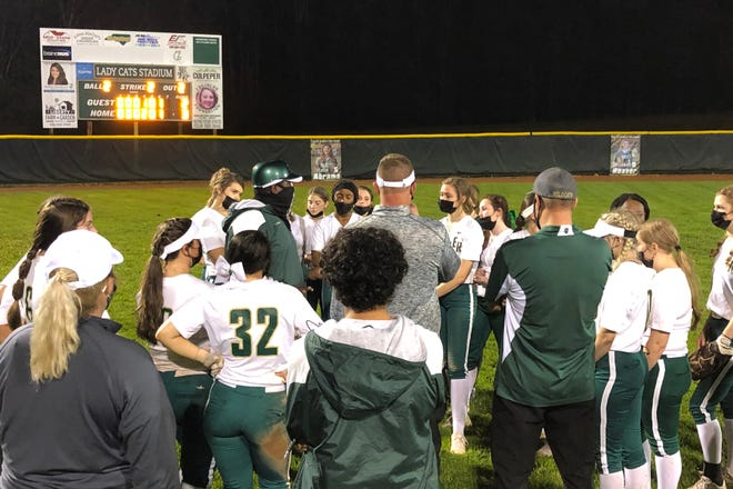 Eastern Randolph softball players and coaches gather after the Wildcats' 3-2 win over Southern Alamance on Saturday. [Cecil Mock for The Courier-Tribune]