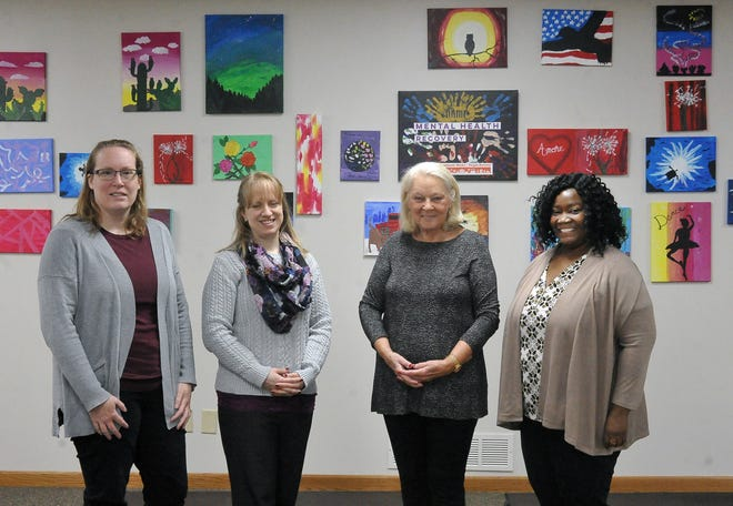 Employees at NAMI are, from left, Dawn Ross, program and office manager; Jen Gwinn, director of advancement; Helen Walkerly, executive director; and Jackie Hunter, MOCA House manager.