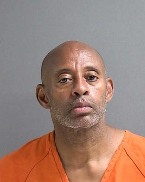 DeLand police said Mack Smith, 60, stabbed another man multiple times outside a convenience store, killing him.