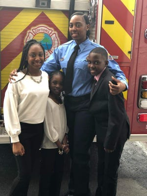 Alicia Shepard is Daytona Beach's first Black female firefighter. She was hired in early 2019, a fulfillment of a career dream that started when the 33-year-old was 6 years old. She's pictured with her three children. (Photo provided by Alicia Shepard)