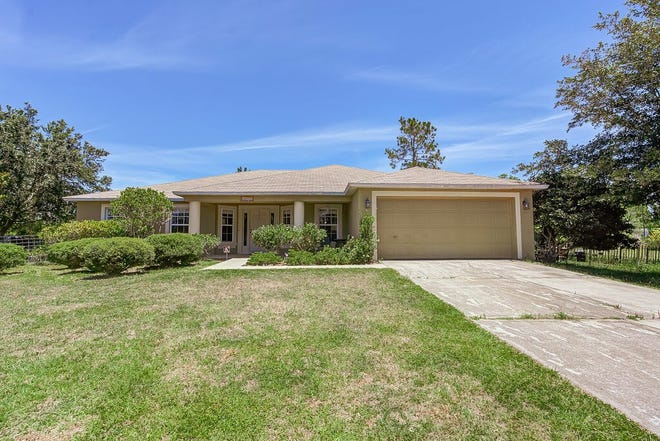 Sitting on five private and fenced acres in DeLeon Springs, this spacious, move-in-ready home has been lovingly maintained and updated throughout the years.