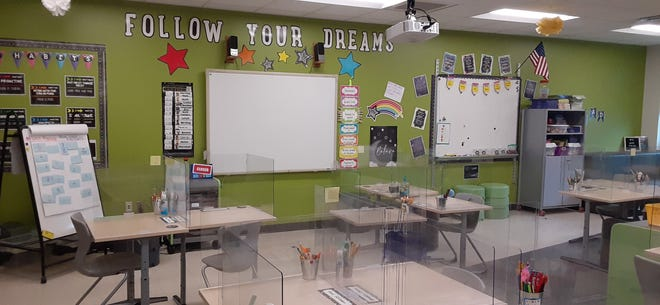 This third grade classroom in the Dansville Central School District reopened to students March 15 with special barriers at each desk in place.