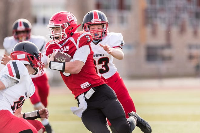 Canisteo-Greenwood's Roque Santiago scrambles for a big gain during Saturday's win over Bolivar-Richburg in Hornell.