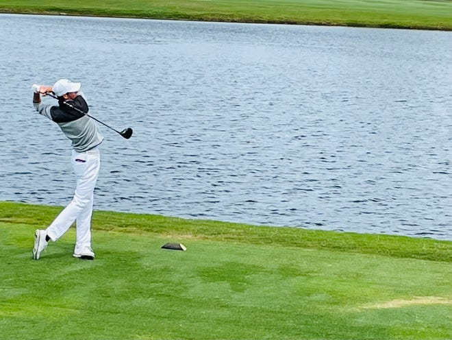 Nick Gabrelcik of the University of North Florida follows through on his drive at the par-5 18th hole of the Sawgrass Country Club on Monday. He won the individual title in The Hayt, at 10-under 206.