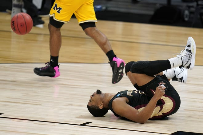 Florida State guard M.J. Walker tumbles to the floor in pain after suffering a left ankle injury in the second half of Sunday's 76-58 loss to Michigan in the NCAA Sweet 16 at Bankers Life Fieldhouse in Indianapolis.