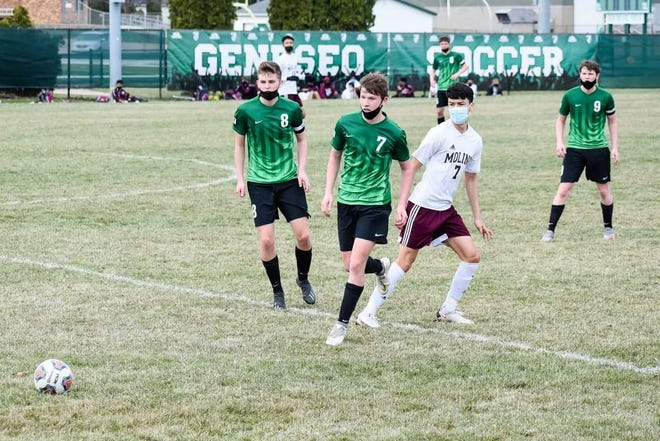 Geneseo soccer players from left, co-captain Ethan Holke (8); co-captain Nate Holke (9), and forward Hunter Holke (7) on the field in the game against Moline when the Leafs won 1-0.