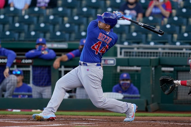 Chicago Cubs first baseman Anthony Rizzo takes a swing at a pitch against the Cincinnati Reds during the first inning of a spring training game Saturday, March 27, 2021, in Goodyear, Ariz.