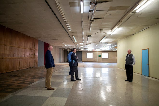 From left, Galesburg Community Foundation Director of Finance & Operations Shawn Hedden, foundation President & CEO Joshua Gibb, and board Chairman Dr. John McClean explore a room inside the building located at 876 W. Main St., where the Community Foundation and River Bend Food Bank have established a formal parternship to bring a Regional Food Bank branch to the site, which many know as the former home of Rheinschmidt's Carpet Center.