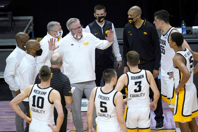 Iowa head coach Fran McCaffery, center, talks to his players during the second half of a first round NCAA tournament game against Grand Canyon Saturday, March 20, 2021, at the Indiana Farmers Coliseum in Indianapolis.
