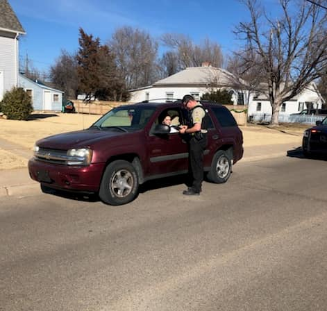 A Great Bend Police Department officer speaks with a driver during the SAFE Enforcement Campaign, held between Feb. 22 and March 5 near high schools across Kansas to encourage teens to drive safely.