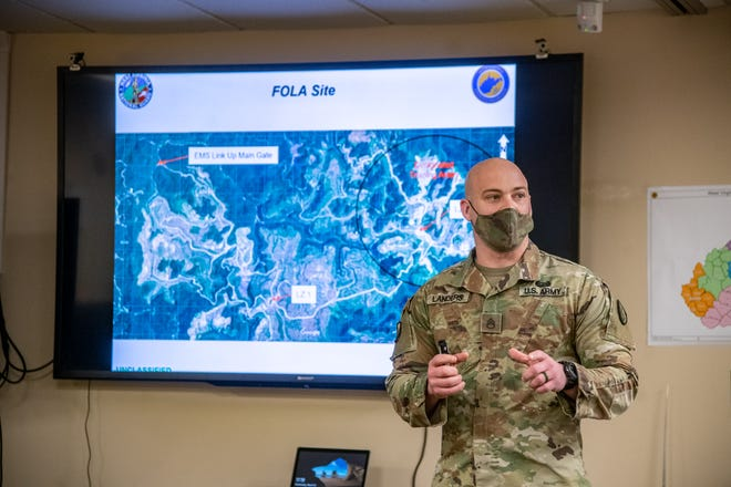 A member of the National Guard in West Virginia discusses emergency management plans in this March 2021 photo.
