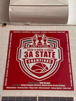One of the banners on the wall of the Potterdome, the Morton High School gymnasium, that heralds the three state titles the girls basketball team won in a row from 2015 through 2017.