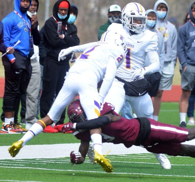 Bethel sophomore Trey Palmer brings down Kansas Wesleyan junior Drevon Macon during play Saturday at Thresher Stadium.