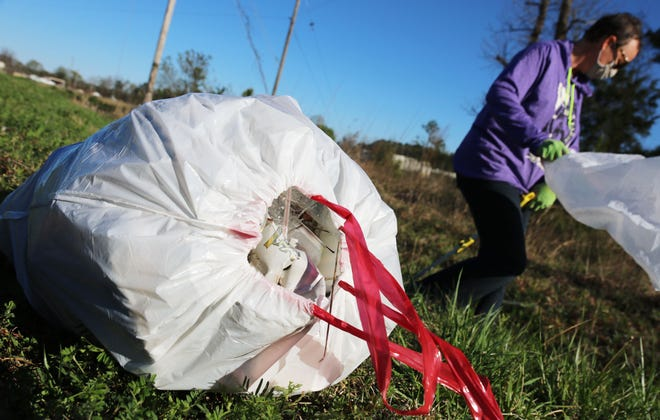 Kinston's Trash Bashers filled trash bags Monday, March 29, on Cunningham Road.