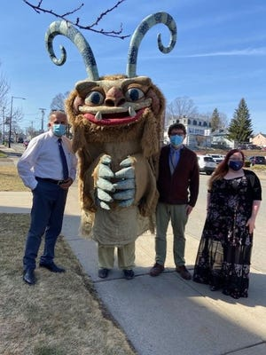 On Thursday, March 25, Hodge Podge visited the Leominster Public Library for a curbside visit. Goodie bags were distributed, and photos were taken. Pictured are, from left, Mayor Dean J. Mazzarella, Library Director Alexander Lent and Assistant Library Director Nicole Piermarini.