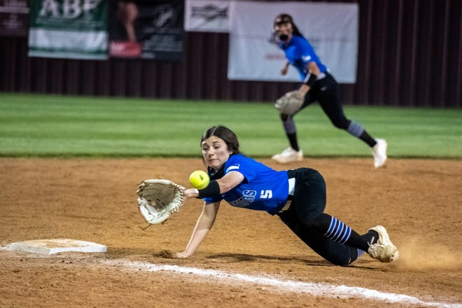 Midlothian third baseman Carsen Kitchens dives for a hard ground ball during Friday night's District 14-5A game in Ennis. The Lady Panthers suffered their second district loss, 13-7.