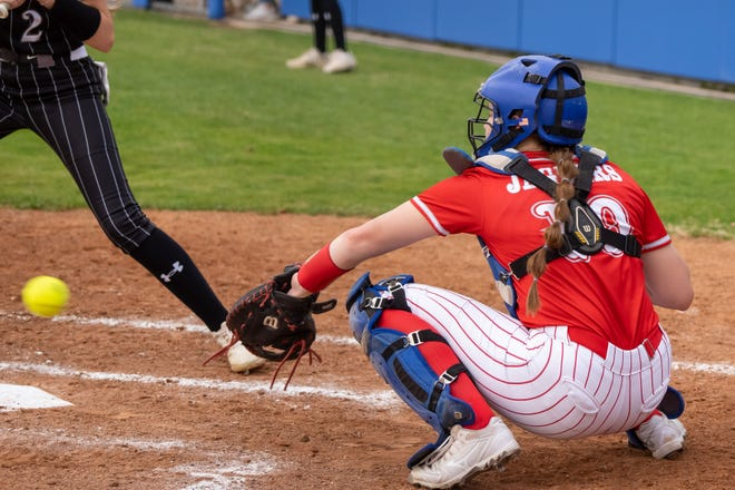 Heritage catcher Elizabeth Schmidt (10) receives a low pitch during a game earlier this month. Schmidt had a huge day at the plate at Kennedale with a grand slam, three doubles and five RBI, but the Jaguars suffered a wild 18-14 loss.