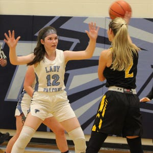 Frankfort's Arin Lease defends Keyser's Maddy Broadwater in Friday night action.Lease would help lead Frankfort to victory with 10 points. Broadwater would contribute seven points for Keyser in the loss.