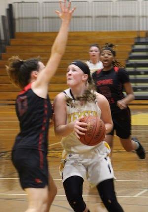 Keyser's Alexa Shoemaker drives to the basket against Spring Mills. Shoemaker scored 14 points to help lead Keyser in the loss.
