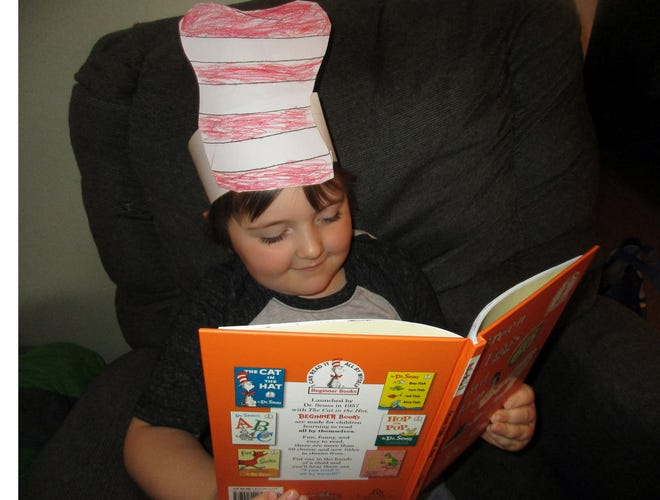 Noah Walker of Vernon enjoys learning to read thanks to his favorite author Dr. Seuss.