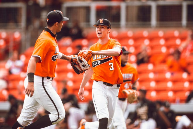 Oklahoma State's Bryce Osmond, right, celebrates after getting an out against Vanderbilt earlier this season. Bruce Waterfield/OSU Athletics