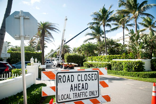 Seagate Road off North Ocean Boulevard was partially closed to traffic in this October photo as Wilco Electrical employees removed utility poles as part of the town's burial of overhead utility lines.