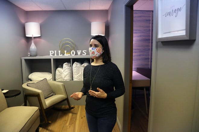"""Krista Maltais, founder and owner of Relief Parenting Respite and Resource Center, gives a tour of her Hampton, New Hampshire, facility, which focuses on bringing relief to parents and families. The """"respite room,"""" pictured, is a place where parents can nap."""