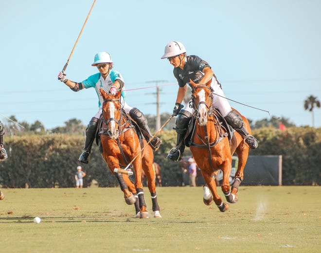 Grant Ganzi of Casablanca, left, closely defends Jeta Castagnola of Richard Mille during Sunday's match at Grand Champions Polo Club.