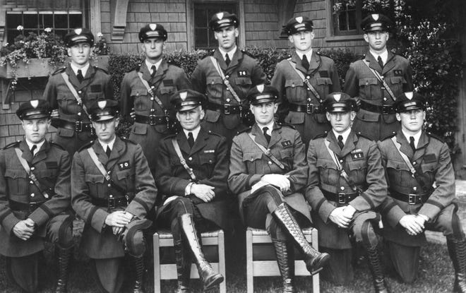 Rhode Island State Police troopers in 1930. Front row, from left: Sherwood Healey, John Kenny, Col. Everitte St. John Chaffee, Lt. H.L. Siteman, Charles R. Blake and Charles Sullivan. Rear row, from left: John Sheehan, J. Charles Gallagher, Malcolm Jeffrey, Arthur Staples and Wilfred Gates.