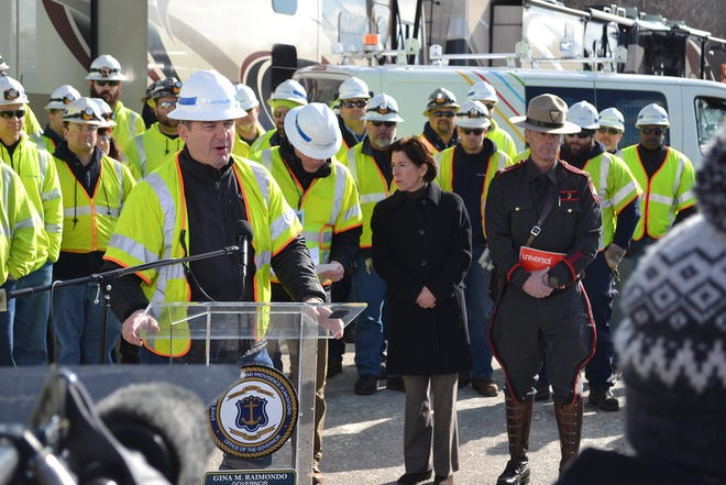 National Grid Chief Gas Engineer Ross Turrini addresses the media in Newport as Gov. Gina Raimondo listens during the natural-gas outage in January 2019.