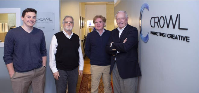 Jeff Crowl (right) stands with (from left) Drew McGregor, Rod A. Covey and Rod McGregor, at the offices of Crowl Marketing Creative. Crowl has worked 50 years in advertising and marketing.