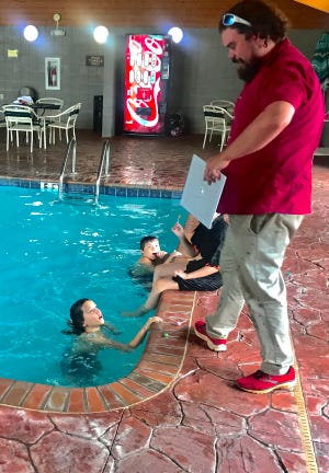General Manager Walter Hoyle interacts with kids in the indoor swimming pool.