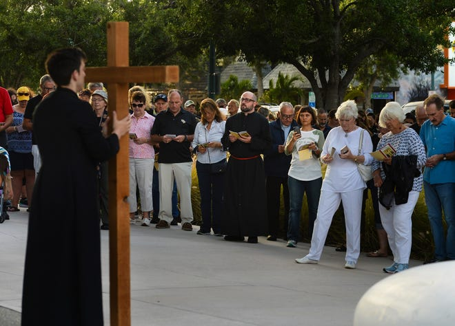 Roughly 900 people walked Main Street in Sarasota during a Stations of the Cross procession on Good Friday in 2019. The Sarasota Ministerial Association and Church of the Redeemer organize the annual observance where the procession pauses for prayer at 14 stations, reflecting on the suffering and crucifixion of Jesus Christ.